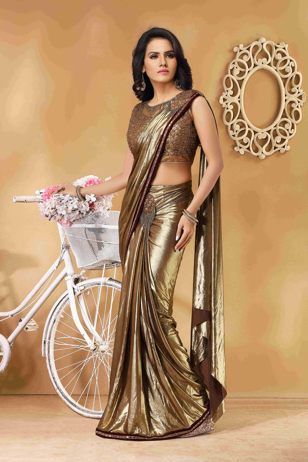 Standout in this gleaming ready to wear sari