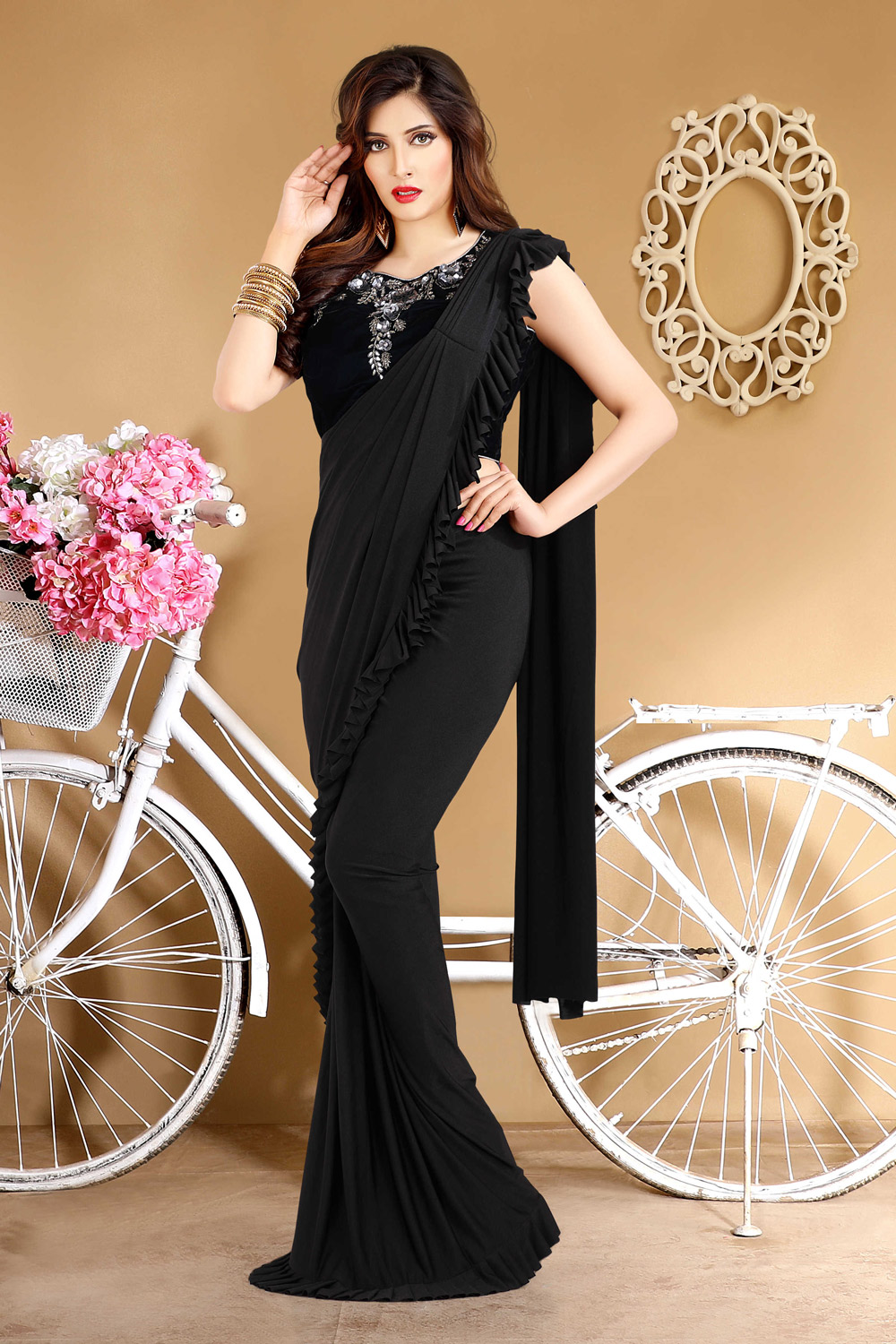 Bold black pre-stitched sari with embroidered blouse