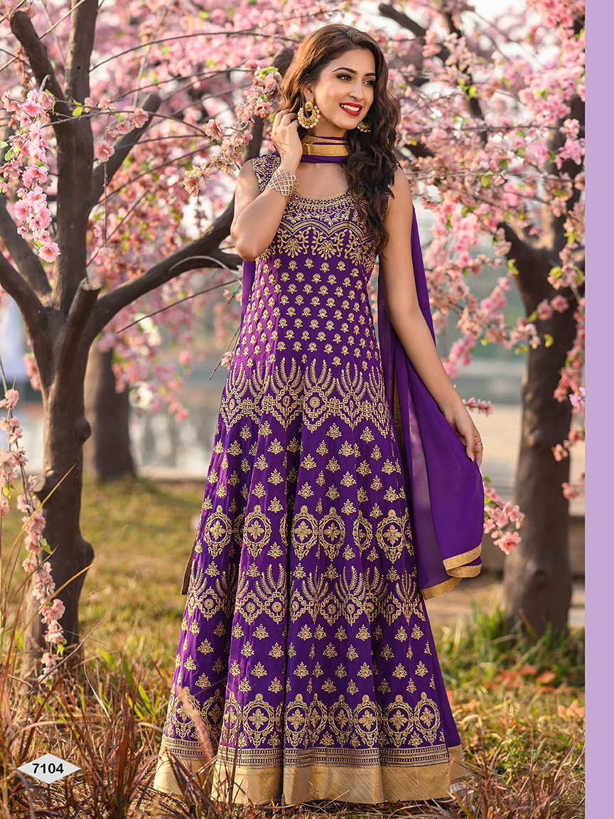 Violet colored viscose georgette anarkali with heavy golden thread detailing