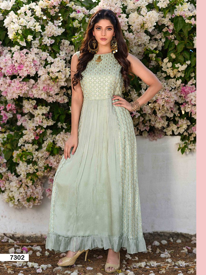 Beautiful mint green flowy chinon kurti with a brooch